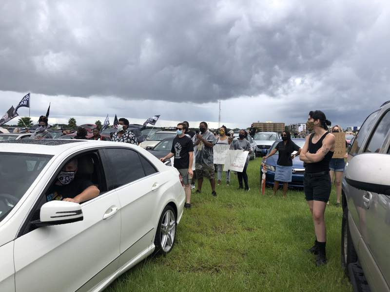 A drive-in rally was held Saturday afternoon in Jacksonville to demand police reform.