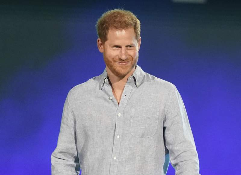 """FILE - In this May 2, 2021, file photo, Prince Harry, Duke of Sussex, speaks at """"Vax Live: The Concert to Reunite the World"""" in Inglewood, Calif. Prince Harry took a break from paternity leave to spread the news about his Invictus Games. The Duke of Sussex announced in an Instagram post Wednesday, June 9, 2021, that the Invictus Games will take place in Dsseldorf, Germany, in 2023. (Photo by Jordan Strauss/Invision/AP, File)"""