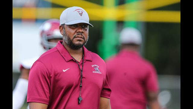 Raines head coach Deran Wiley watches his team during warmups before a football game against Ribault at Ribault High School in Jacksonville, Fla., Saturday, Oct. 12, 2019. [Gary Lloyd McCullough/ For News 4 JAX]