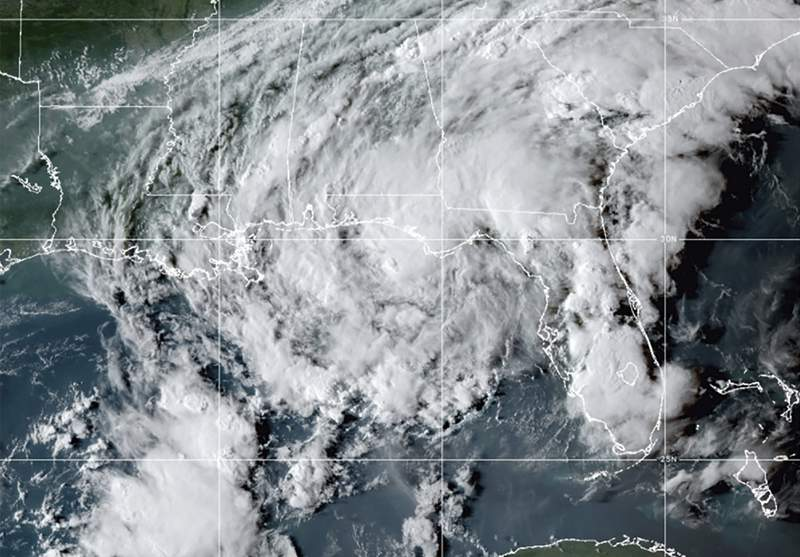 This GOES- East GeoColor satellite image taken Wednesday, Sept. 8, 2021, at 10:30 p.m. EDT., and provided by NOAA, shows Tropical Storm Mindy as it makes landfall on the Florida Panhandle. The storm touched down over St. Vincent Island, about 10 miles (15 km) west southwest of Apalachicola, according to the National Hurricane Center.   (NOAA via AP)