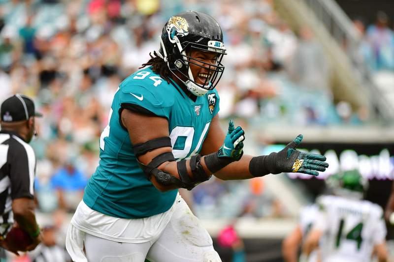 Dawuane Smoot of the Jacksonville Jaguars reacts after sacking Sam Darnold of the New York Jets in the second quarter of a football game at TIAA Bank Field on October 27, 2019 in Jacksonville, Florida. (Photo by Julio Aguilar/Getty Images)