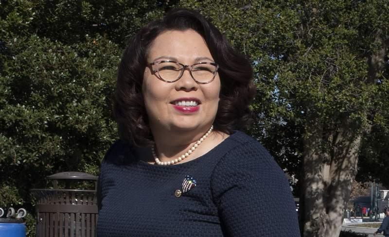 """FILE - Sen. Tammy Duckworth, D-Ill., arrives at the Capitol in Washington on Jan. 22, 2020. Duckworth' memoir titled """"Every Day Is a Gift"""" comes out March 30. The Hachette Book Group imprint Twelve announced the deal with Sen. Duckworth on Thursday, Nov. 12, 2020, on the 16th anniversary of when she was shot down while serving in Iraq and lost both of her legs. (AP Photo/Cliff Owen, File)"""