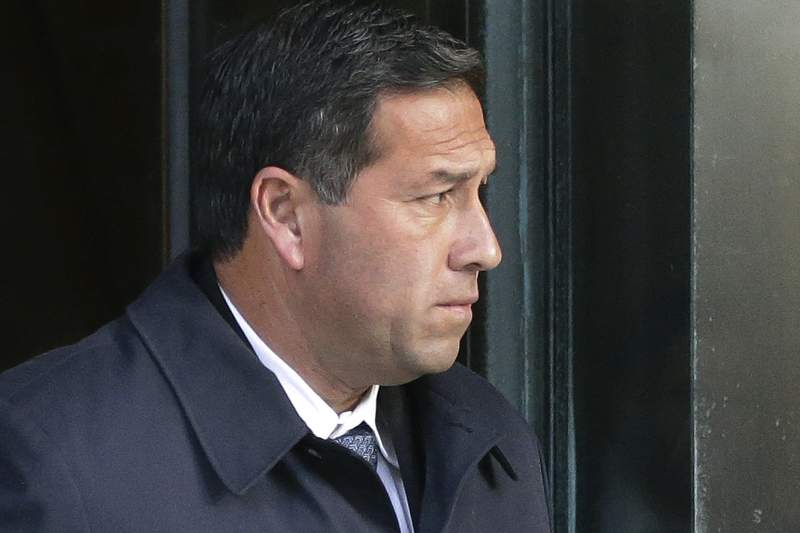 FILE - In this March 25, 2019, file photo Jorge Salcedo, former University of California at Los Angeles men's soccer coach, departs federal court in Boston after facing charges in a nationwide college admissions bribery scandal. Salcedo pleaded guilty in April 2020, and was sentenced to eight months behind bars Friday, March 19, 2021, for pocketing $200,000 in bribes to help applicants get into the school as bogus athletic recruits. (AP Photo/Steven Senne, File)