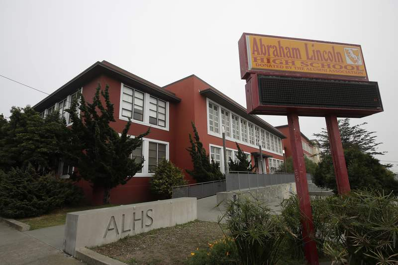FILE - This Thursday, March 12, 2020 shows Abraham Lincoln High School in San Francisco. Staggered start times. Classes cut in half. Social distancing in the hallways and cafeteria. Classes on, then off again. These are just a few of the possible scenarios for California schools after  California Gov. Gavin Newsom laid out a roadmap for reopening the state amid the coronavirus outbreak. (AP Photo/Jeff Chiu,File)