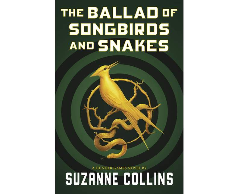 """This cover image released by Scholastic shows """"The Ballad of Songbirds and Snakes,"""" a Hunger Games novel by Suzanne Collins, to be published on May 19. Lionsgate is working on a film adaptation of the """"Hunger Games"""" prequel. Collins' novels have sold tens of millions of copies and the film versions, which starred Jennifer Lawrence as heroine Katniss Everdeen, have earned nearly $3 billion.(Scholastic via AP)"""