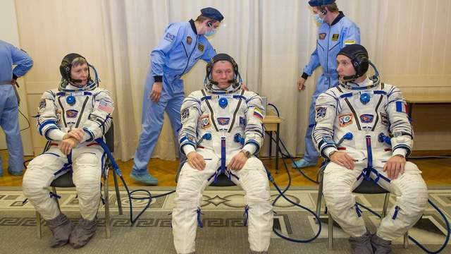 Expedition 50 NASA astronaut Peggy Whitson, left, Russian cosmonaut Oleg Novitskiy of Roscosmos, center, and ESA astronaut Thomas Pesquet are seen after donning their Russian sokol suits a few hours ahead of their launch on a Soyuz rocket, Thursday, Nov. 17, 2016, in Baikonur, Kazakhstan. Whitson, Novitskiy, and Pesquet launched in their Soyuz MS-03 spacecraft to the International Space Station to begin a six-month mission. Photo Credit: (NASA/GCTC/Irina Peshkova)