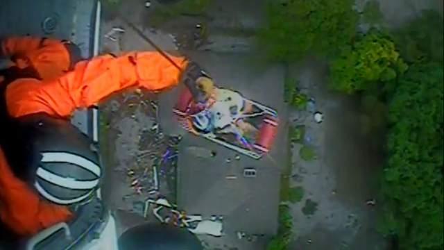 Coast Guard helicopter crew rescues Santa Barbara family Tuesday. (Photo: Coast Guard)
