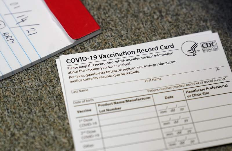 """FILE - In this Dec. 24, 2020, file photo, a COVID-19 vaccination record card is shown at Seton Medical Center during the coronavirus pandemic in Daly City, Calif. Only about 1% of California's 40 million residents have been vaccinated against the coronavirus, setting a pace of immunization that's """"not good enough,"""" Gov. Gavin Newsom said Monday, Jan. 4, 2021. (AP Photo/Jeff Chiu, File)"""