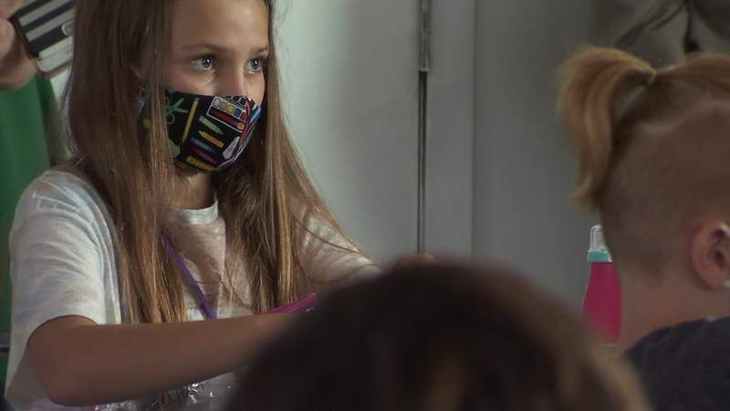 A student in a Clay County school wears a face mask.