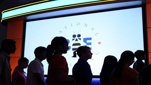 Spellers walk onstage at the start of the second round of the Scripps National Spelling Bee competition.  (Photo by Mark Wilson/Getty Images)