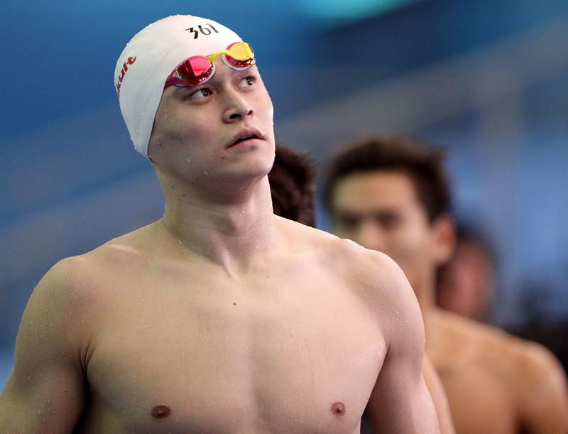 FILE - In this July 26, 2019, file photo, China's Sun Yang leaves the pool deck following the men's 4x200m freestyle relay heats at the World Swimming Championships in Gwangju, South Korea. The World Anti-Doping Agency says a Swiss court has overturned an eight-year doping ban against Chinese swimmer Sun Yang and ordered the case back to the Court of Arbitration for Sport for a second time but with a different chairman of the judges. (AP Photo/Mark Schiefelbein, File)
