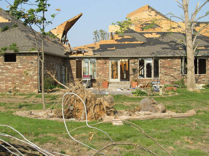 A home stands, but is damaged by a storm.