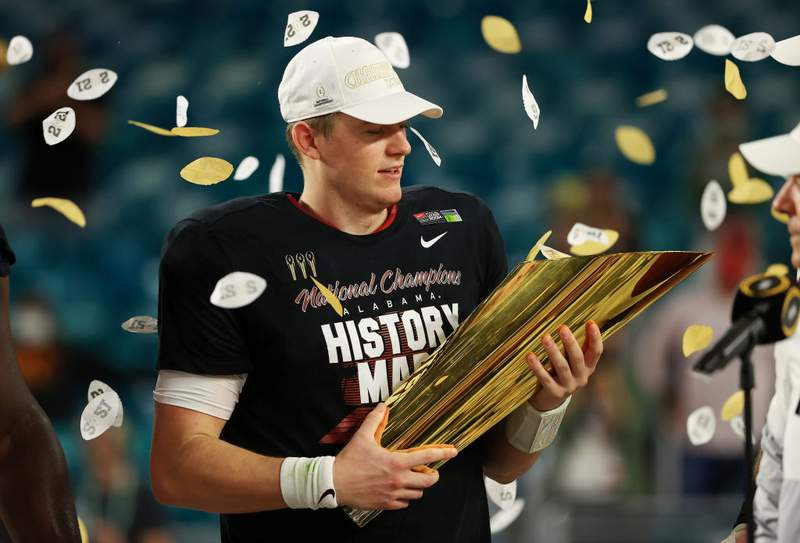 Alabama quarterback Mac Jones holds the trophy following their win over the Ohio State Buckeyes in the College Football Playoff National Championship game at Hard Rock Stadium on January 11, 2021 in Miami Gardens, Florida. (Photo by Mike Ehrmann/Getty Images)