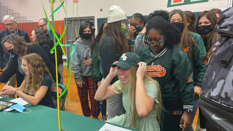 Mandarin softball player Summer Alexander smiles after signing with South Georgia on Wednesday.
