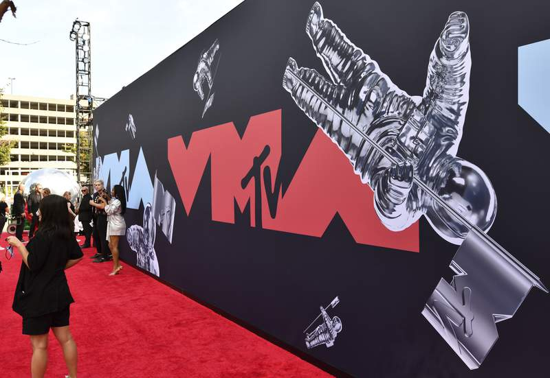 FILE - This Aug. 26, 2019 file photo shows a view of the red carpet at the MTV Video Music Awards in Newark, N.J. An MTV spokesperson said Monday that the show will take place Aug. 30 at the Barclays Center in Brooklyn, New York. (Photo by Charles Sykes/Invision/AP, File)