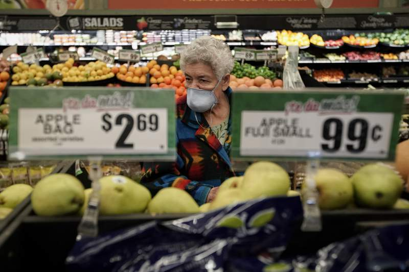 Carmen Zamora shops on Tuesday during special hours her grocery stores set aside for seniors. (Photo/Chris Carlson)