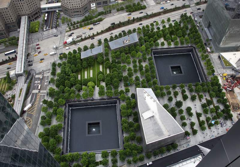 FILE - In this June 7, 2018, file photo, the September 11 Memorial and Museum are seen from an upper floor of 3 World Trade Center in New York. (AP Photo/Mark Lennihan, File)