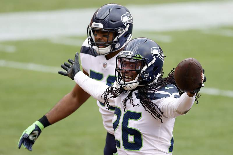 Cornerback Shaquill Griffin #of the Seattle Seahawks celebrates after intercepting a pass against the Washington Football Team in the first half at FedExField on December 20, 2020 in Landover, Maryland. (Photo by Tim Nwachukwu/Getty Images)