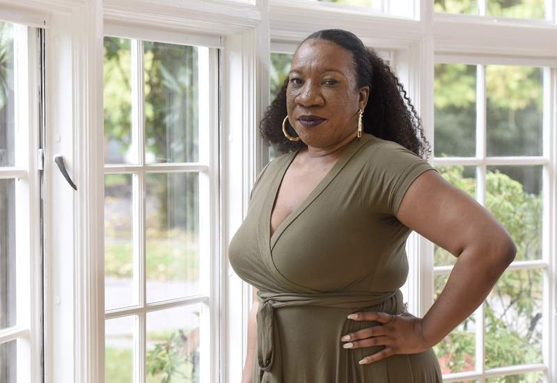 Tarana Burke, founder and leader of the #MeToo movement, stands in her home in Baltimore on Oct. 13, 2020. Black women and girls are now the focus of several high-profile philanthropic initiatives as major donors look to address the racial wealth gap and the long-chronicled funding disparity for organizations serving minority women. Teresa Younger, who helped launch The Black Girl Freedom Fund and its 1Billion4BlackGirls campaign in September with other Black women in philanthropy and activism  including Me Too Founder Tarana Burke  said that donors should be cautious about making assumptions in their giving. (AP Photo/Steve Ruark, file)