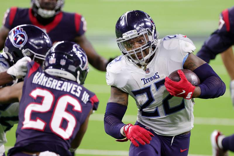 Derrick Henry of the Tennessee Titans runs for yards during the second half of a game against the Houston Texans at NRG Stadium on January 03, 2021 in Houston, Texas. (Photo by Carmen Mandato/Getty Images)