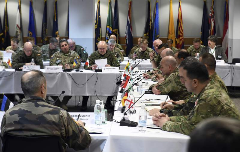 Land Force Commanders from allied NATO and partner nations with Poland's General Jaroslaw Mika, center, met to discuss the execution of DEFENDER-Europe 20 during a conference held at the Headquarters of the U.S. Army in Europe in Wiesbaden, Germany, March 6, 2020. The commander of Poland's armed forces, General Jaroslaw Mika, was diagnosed with the new coronavirus as he returned home, the Polish Defense Ministry said.  For most people, the new coronavirus causes only mild or moderate symptoms, such as fever and cough. For some, especially older adults and people with existing health problems, it can cause more severe illness, including pneumonia.  (U.S. Army Europe/Stephen Perez via AP)