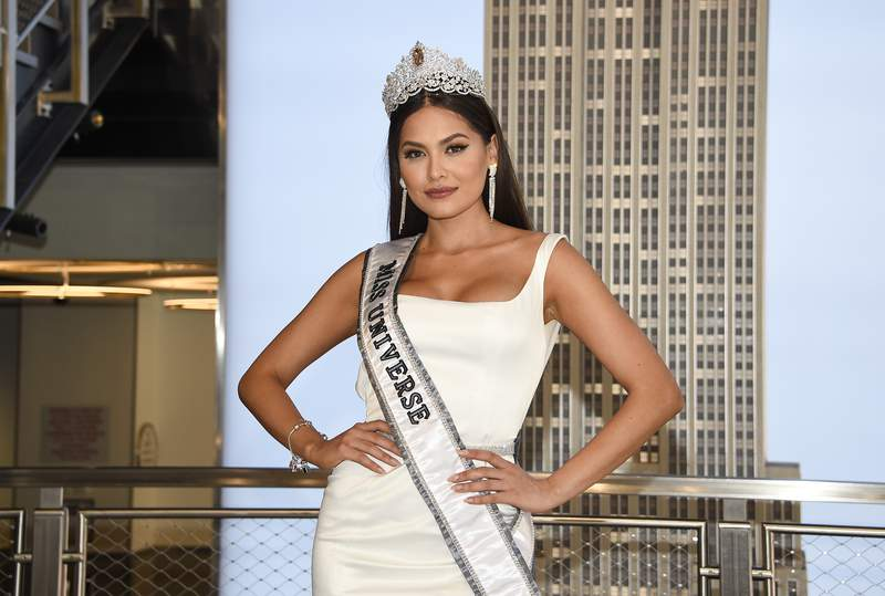 FILE - Newly crowned Miss Universe, Andrea Meza of Mexico, poses for the media during her visit to the Empire State Building on May 18, 2021, in New York. The next Miss Universe competition will take place in December in Eilat, Israel. The Miss Universe Organization also announced Tuesday, July 20, 2021, that the contest will again broadcast live in the U.S. on Fox with Steve Harvey returning to host. This will be the 70th Miss Universe competition and will end with Meza crowning her successor. (Photo by Evan Agostini/Invision/AP, File)