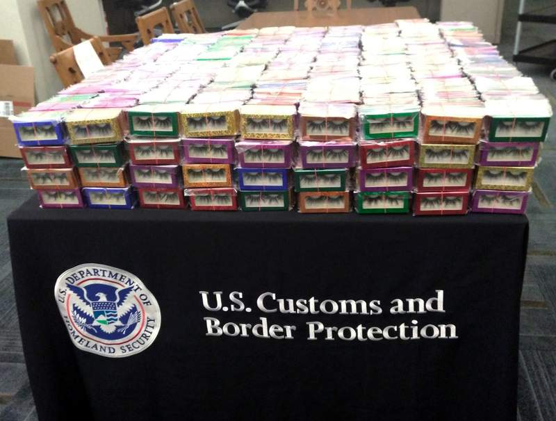 This photo provided by U.S. Customs and Border Protection shows boxes of long lashes seized Tuesday, July 6, 2021 at Louis Armstrong New Orleans International Airport.  Three thousand pairs of false eyelashes have been seized by U.S. Customs and Border Protection agents after officials determined they were illegally imported from China to New Orleans. Agency spokesperson Matthew Dyman tells WVUE-TV that the four boxes of long lashes seized Tuesday were destined for a local beauty supply store.(U.S. Customs and Border Protection via AP)