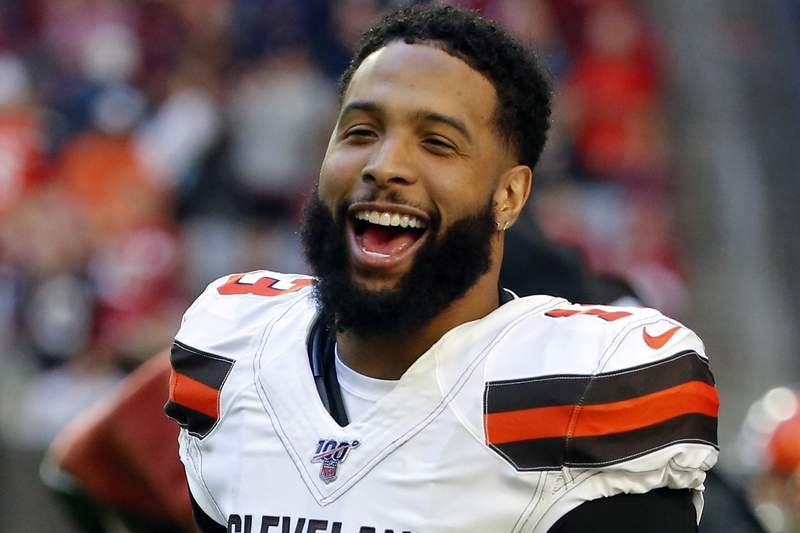 FILE - In this Dec. 15, 2019, file photo, Cleveland Browns wide receiver Odell Beckham (13) laughs during an NFL football game against the Arizona Cardinals in Glendale, Ariz. Beckham, who skipped Cleveland's program last spring after being acquired from the Giants, has been a model guy during the team's virtual program. (AP Photo/Rick Scuteri, File)