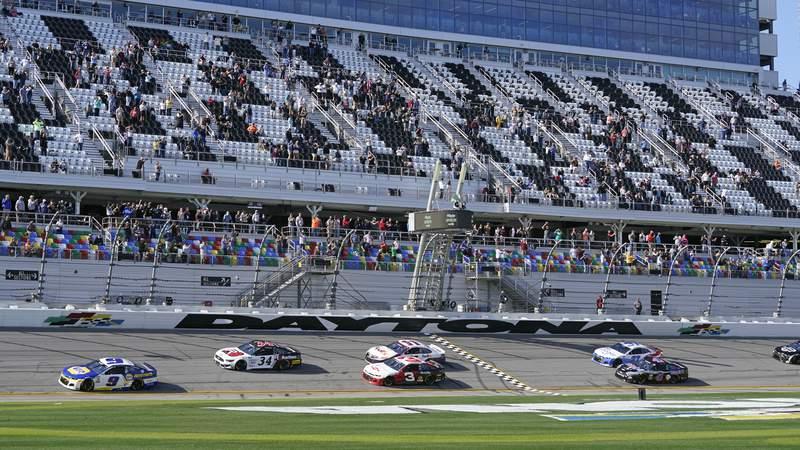 Chase Elliott (9), Michael McDowell (34), Austin Dillon (3), and Denny Hamlin (11) lead the field to start the NASCAR Cup Series road-course auto race at Daytona International Speedway, Sunday, Feb. 21, 2021, in Daytona Beach, Fla. (AP Photo/John Raoux)