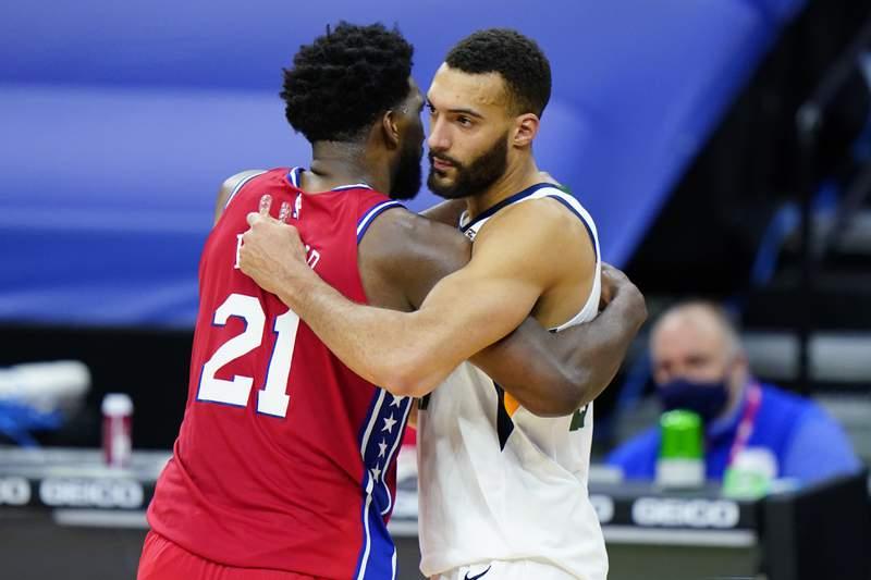 Philadelphia 76ers' Joel Embiid, left, and Utah Jazz's Rudy Gobert meet after an NBA basketball game, Wednesday, March 3, 2021, in Philadelphia. (AP Photo/Matt Slocum)