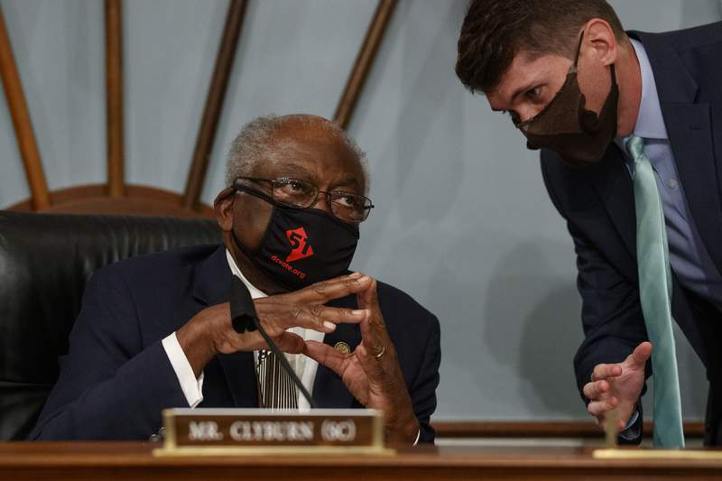 Select Subcommittee on the Coronavirus Crisis chairman Rep. James Clyburn, D-S.C., left, speaks with an aid Capitol Hill in Washington, Friday, June 26, 2020, before a hearing with Gene L. Dodaro, Comptroller General of the United States, about a new report from the U.S. Government Accountability Office (GAO) with recommendations to improve the federal coronavirus response. (AP Photo/Carolyn Kaster)