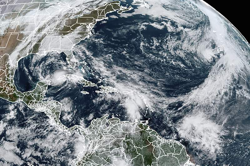 FILE - This Tuesday, Nov. 10, 2020, satellite image made available by NOAA shows Tropical Storm Eta at 10:40 a.m. EST in the Gulf of Mexico, Theta, right, and a tropical wave to the south that became Tropical Storm Iota. An overheating world obliterated weather records in 2020  an extreme year for hurricanes, wildfires, heat waves, floods, droughts and ice melt  the United Nations weather agency reported Wednesday, Dec. 2, 2020. (NOAA via AP)