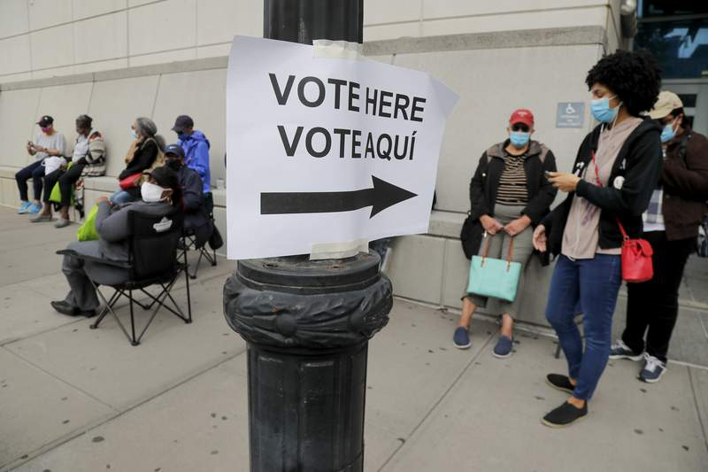 Residents stand in line to vote in Yonkers, N.Y.
