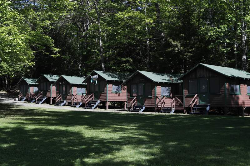 FILE - This Thursday, June 4, 2020 file photo shows a row of cabins at a summer camp in Fayette, Maine. On Friday, May 28, 2021, the Centers for Disease Control and Prevention posted guidance saying kids at summer camps can skip wearing masks outdoors, with some exceptions. Children who arent fully vaccinated should still wear masks outside when theyre in crowds or in sustained close contact with others  and when they are inside, and fully vaccinated kids need not wear masks indoors or outside, the CDC says. (AP Photo/Robert F. Bukaty, File)