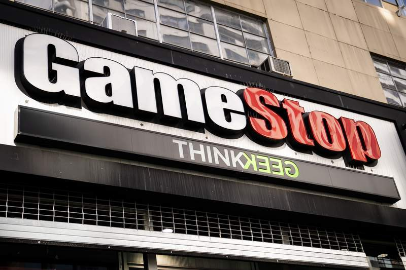 FILE - Pedestrians pass a GameStop store on 14th Street at Union Square, Thursday, Jan. 28, 2021, in the Manhattan borough of New York.  Meme stock GameStop is gearing up to name Ryan Cohen as its chairman on Wednesday, June 9,  when the video game retailer holds its annual shareholders meeting.  (AP Photo/John Minchillo, File)