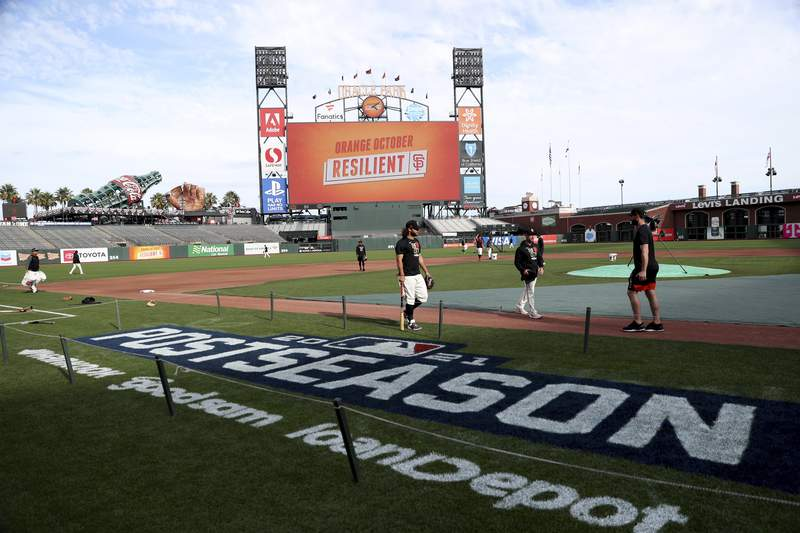The San Francisco Giants work out Thursday, Oct. 7, 2021, in San Francisco for the baseball team's National League Division Series against the Los Angeles Dodgers, which starts Friday. (AP Photo/Jed Jacobsohn)