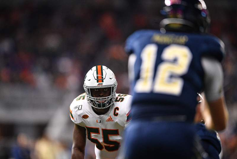 Shaquille Quarterman #55 of the Miami Hurricanes lines up against the FIU Golden Panthers in the second quarter at Marlins Park on November 23, 2019 in Miami, Florida. (Photo by Mark Brown/Getty Images)