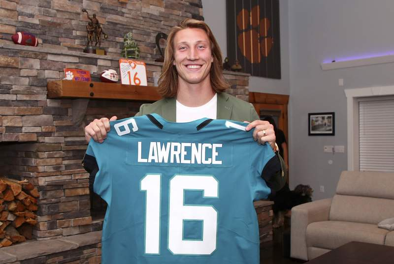 In this handout photo provided by the National Football League, quarterback Trevor Lawrence poses after being selected with the first overall pick by the Jacksonville Jaguars in the 2021 NFL Draft on April 29, 2021 in Seneca, South Carolina. (Photo by Logan Bowles/NFL via Getty Images)