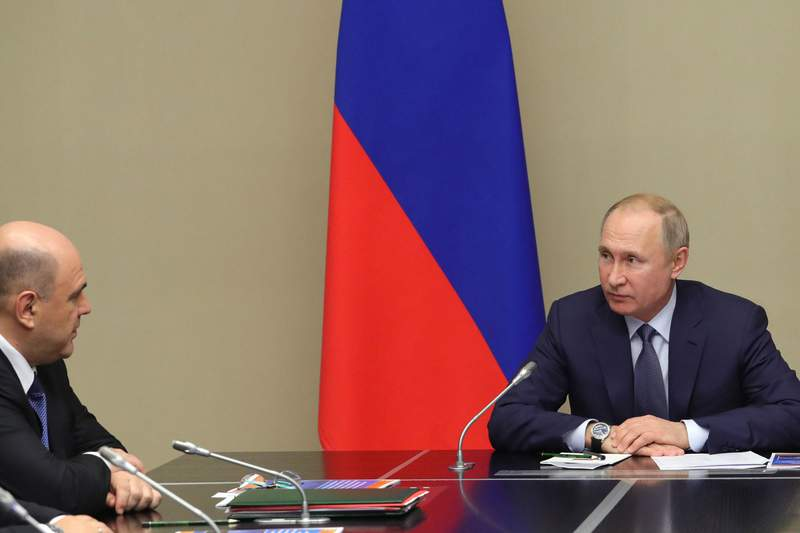 Russian President Vladimir Putin, right, and New Russian Prime Minister Mikhail Mishustin attend a Security Council meeting at the Novo-Ogaryovo residence outside Moscow in Moscow, Russia, Monday, Jan. 20, 2020. (Mikhail Klimentyev, Sputnik, Kremlin Pool Photo via AP)