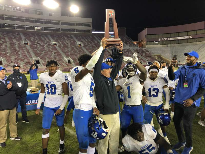 Trinity Christian coach Verlon Dorminey celebrates after winning the Class 3A state title with a 25-22 win over Chaminade Madonna on Wednesday night.