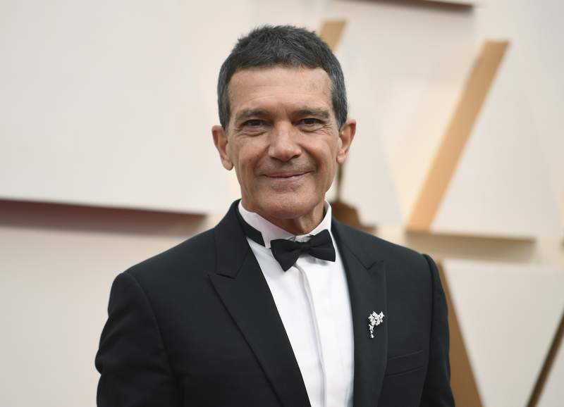 FILE - Antonio Banderas arrives at the Oscars in Los Angeles on Feb. 9, 2020.  Banderas says hes tested positive for COVID-19 and is celebrating his 60th birthday in quarantine. The Spanish actor announced his positive test on Instagram on Monday. (Photo by Richard Shotwell/Invision/AP, File)