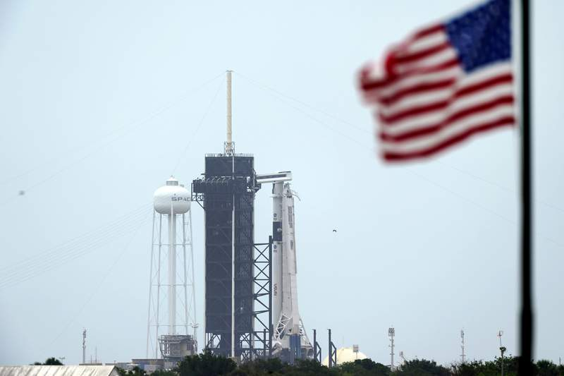 The SpaceX Falcon 9, with the Crew Dragon spacecraft on top of the rocket, sits on Launch Pad 39-A.