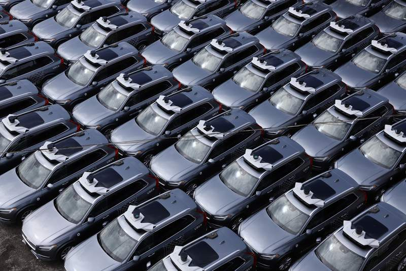 File-This March 20, 2020, file photo shows a parking lot full of Uber self-driving Volvos in Pittsburgh. (AP Photo/Gene J. Puskar, File)