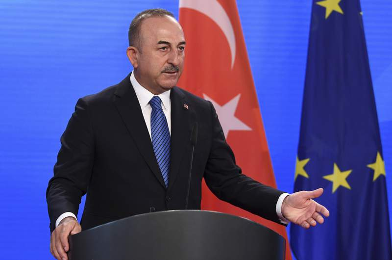 Turkish Foreign Minister Mevlut Cavusoglu gives a statement to the media following a meeting with German Foreign Minister Heiko Maas at the foreign ministry in Berlin, Germany May 6, 2021.  (Annegret Hilse/Pool via AP)