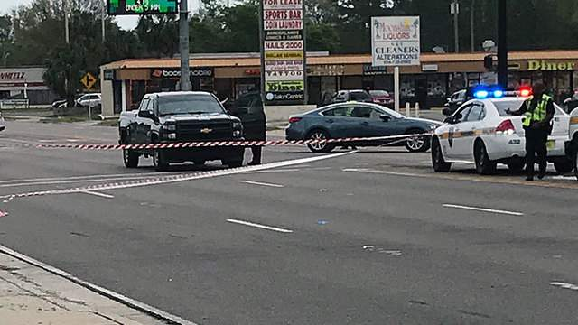 A bicyclist died Sunday after falling off their bike onto Atlantic Boulevard and being hit by a tow truck, police say