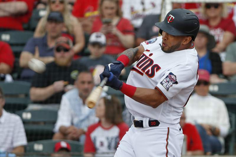 FILE - Minnesota Twins' Eddie Rosario hits the ball during a spring training baseball game against the St. Louis Cardinals in Fort Myers, Fla., in this Monday, March 9, 2020, file photo. The Indians officially signed free agent outfielder Eddie Rosario, adding a quality player who pounded their pitchers in recent years. Rosario passed his physical on Thursday, Feb. 4, 2021, to finalize a one-year, $8 million contract for 2021.(AP Photo/Elise Amendola, File)