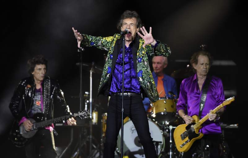FILE - In this Aug. 22, 2019 file photo, Mick Jagger, center, performs with his Rolling Stones bandmates, from left, Ron Wood, Charlie Watts and Keith Richards during their concert at the Rose Bowl in Pasadena, Calif.  The Stones announced Thursday, July 22, 2021, that they will relaunch their U.S. tour on Sept. 26 in St. Louis. Their revived tour will include some new dates in Los Angeles, Las Vegas and a show at the New Orleans Jazz and Heritage Festival.  (Photo by Chris Pizzello/Invision/AP, File)