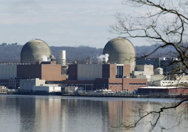 FILE - This Feb. 28, 2017, file photo shows Indian Point Energy Center in Buchanan, N.Y. The 1,020-megawatt Unit 2 reactor at the Indian Point Energy Center along the Hudson River will close for good Thursday, April 30, 2020 and 1,040-megawatt Unit 3 will close in April 2021, as part of a deal reached in January 2017 between Entergy Corp., the state of New York and the environmental group Riverkeeper.  (AP Photo/Seth Wenig, File)