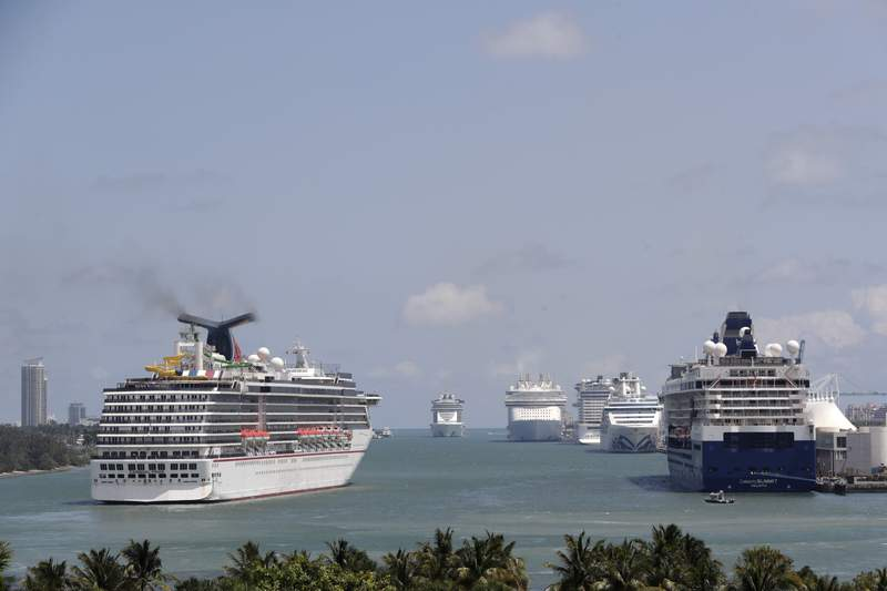 FILE - The Carnival Pride cruise ship arrives at PortMiami, Tuesday, April 7, 2020, in Miami. (AP Photo/Lynne Sladky)