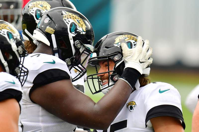 Gardner Minshew celebrates with Cam Robinson  of the Jacksonville Jaguars after a 27-20 win over the Indianapolis Colts at TIAA Bank Field on September 13, 2020 in Jacksonville, Florida. (Photo by Julio Aguilar/Getty Images)